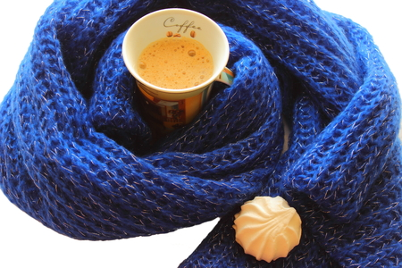 marshmallows and a cup of coffee in a scarf photo