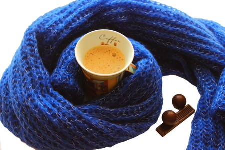 cup of coffee and chocolate in a scarf and chocolates candies photo