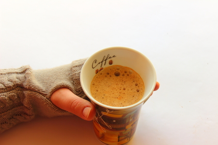 on a light gray background hot coffee in hand photo