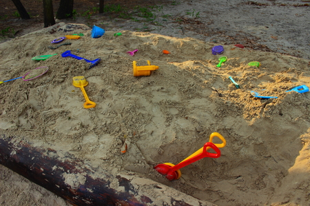 childrens': in the childrens sandbox are childrens toys