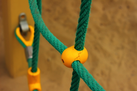 rope ladder: yellow plastic mount for a childs rope ladder
