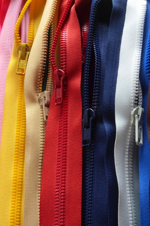 outer clothing: hangs a large number of zippers on jackets Stock Photo