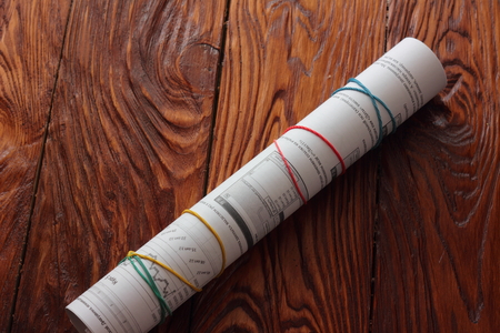 nformation: Financial paper rolled into a tube with rubber bands