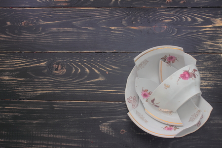 household accident: on a wooden board of the battered plates