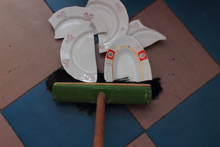 household accident: broom cleaning residues crashed saucers