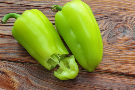 ailment: on a wooden board on two sweet peppers