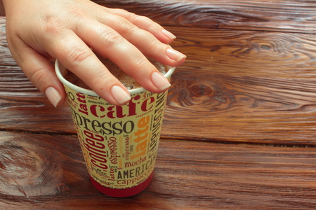 paper cup: paper cup with coffee served by hand