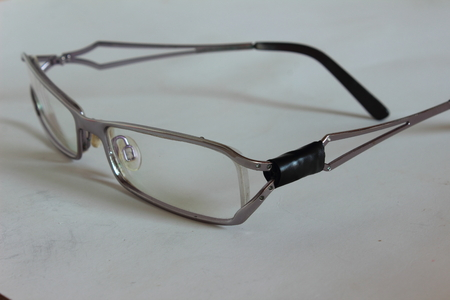 vision repair: Optical glasses are repaired with temples