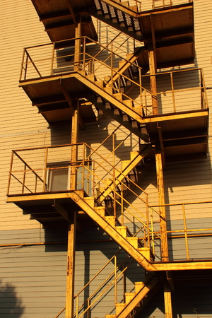 steps and staircases: outdoor metal staircase lifting up Stock Photo