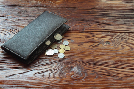 economise: lie on the board and change purse Stock Photo