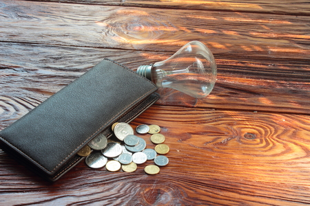 oncept: lie on a wooden board lamp, wallet, coin