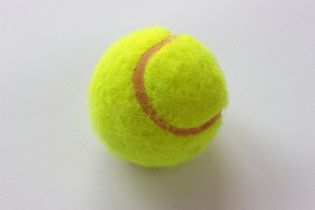 yellow ball: is a tennis ball close up Stock Photo