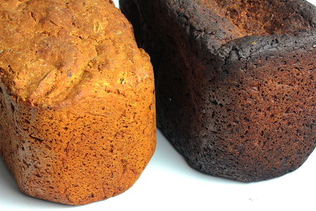 not ready: close-up of freshly baked bread and burnt