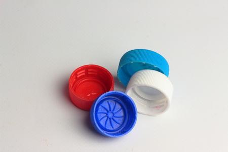 Plastic bottle caps are of different colors Reklamní fotografie
