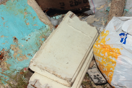 putrefy: on the street are concrete slabs, wooden boards, bags of garbage