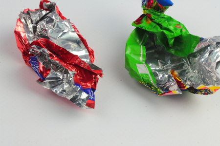 wrappers: are two empty candy wrappers from sweets