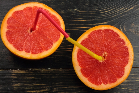 c vitamin: halves of grapefruit, which are inserted in the tube