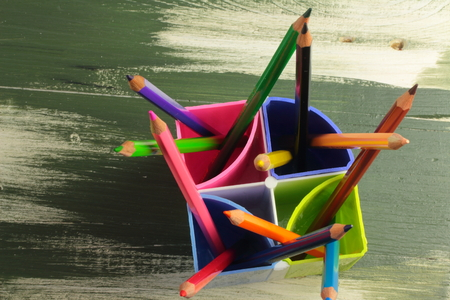art supplies: on a wooden board and colored pencils stand for office supplies