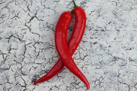 spicey: on a wooden board is bitter couple of peppers