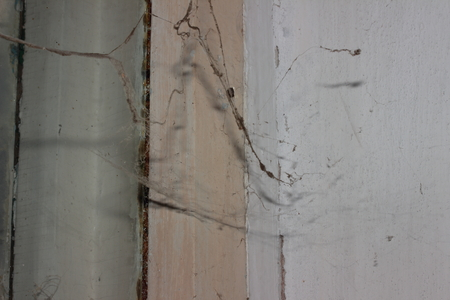 cobwebs: cobwebs hanging on the wall inside the house Stock Photo