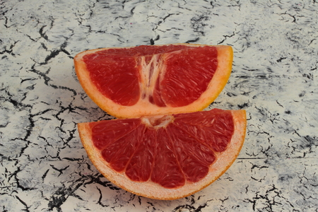 quarters: on a wooden board based on two quarters of grapefruit