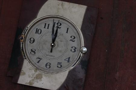 cleave: lie on a wooden board old broken clock