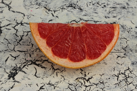 quartered: on a wooden board is quartered grapefruit Stock Photo
