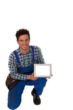 Young craftsman   artisan with a tool belt and tablet isolated on white background photo