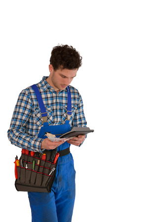 Young craftsman   artisan with a tool belt, money and a calculator isolated on white background photo