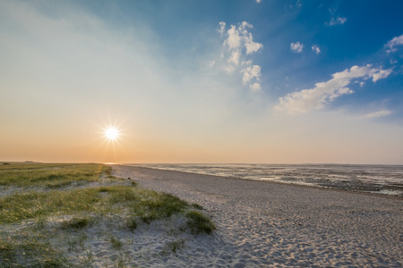 Beautiful beach of the german North sea sundown photo