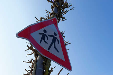 be careful: Warning sign in front of blue sky