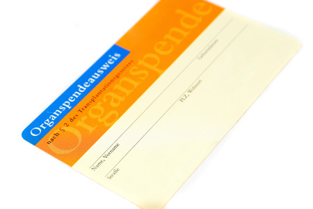 Organ donor card in front of white background