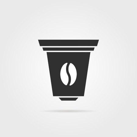 Black coffee capsule icon with shadow