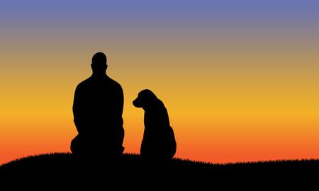 Homme avec des silhouettes de chien tandis que le coucher du soleil