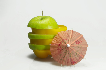 sliced apple: Sliced apple with pepper and umbrella