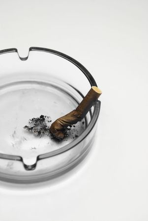Smoking cigarette in an ashtray photo