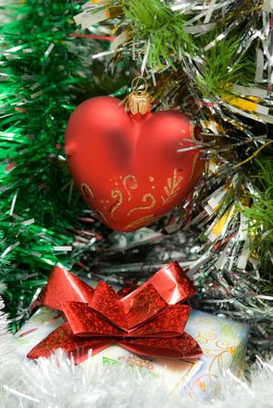 red heart on fir branch with gift box photo