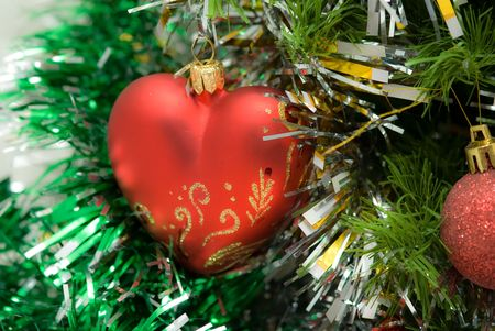 red heart on fir branch decoration on garland photo