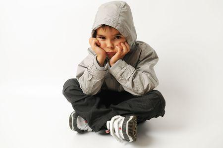 children sad: sad boy sitting on the floor