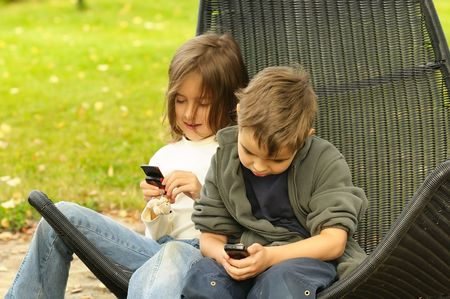 kids  playing in a  mobile phone photo
