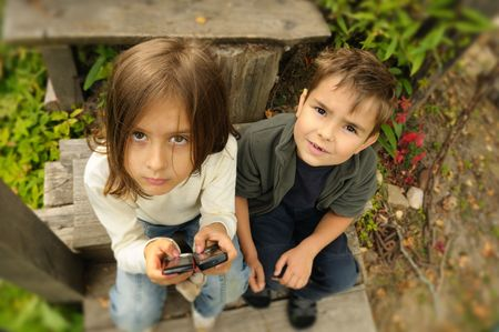 kids  playing in a  mobile phone Stock Photo - 5570484
