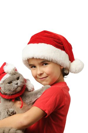 Young boy in santa hat with santa cat on white background photo