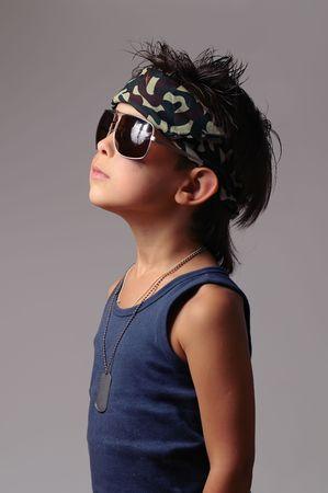 Military kid in bandana with dog tag photo