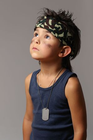 Military kid in bandana with dog tag photo