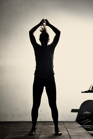 burpee: girl athlete making burpees