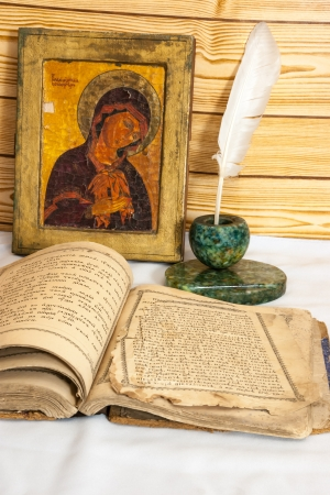 Icon the bible and inkwell photo