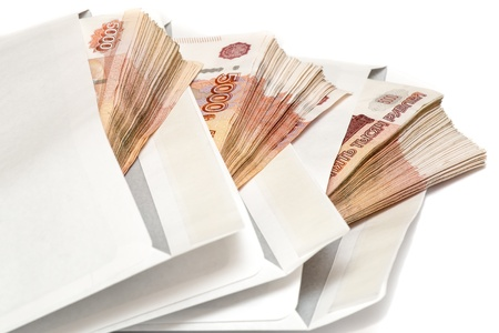 Pack of Russian banknotes in envelope on white background Stock Photo