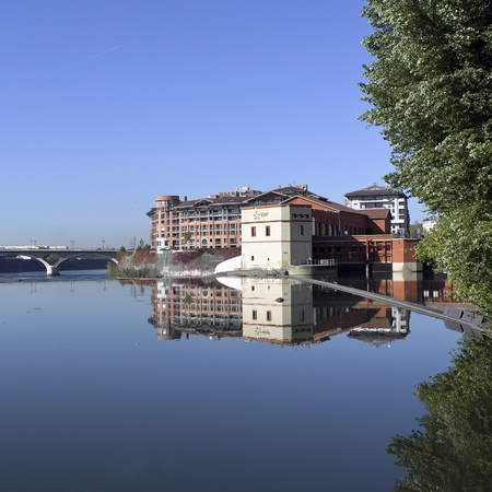 toulouse, france, reflection of the neighborhood bazacle on the garonne Editorial