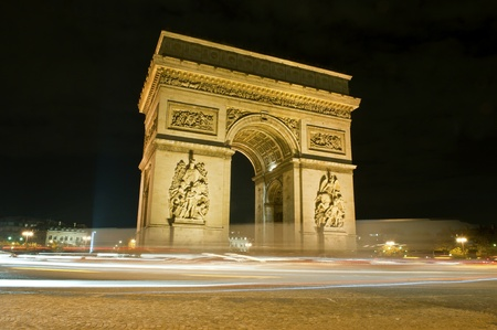 triumphal arch at night in Paris, France