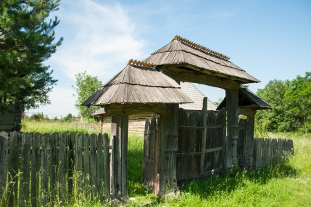 Old wooden gate in a traditional Romanian style photo